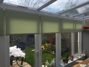 Green Roller Blinds in conservatory