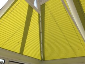 Green Pleated Blinds in conservatory